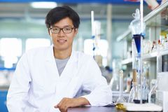 Asian Laboratory scientist working at lab with test tubes. One male Chinese Laboratory scientist working at lab with test tubes Royalty Free Stock Images