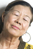 Asian Lady. Portrait of a happy smiling asian woman royalty free stock photo