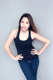 Asian lady action in black vest and jeans Royalty Free Stock Photos