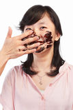 Asian lady and chocolate Royalty Free Stock Photos
