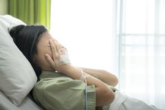 Asian lady cry in patient room in hospital royalty free stock photos