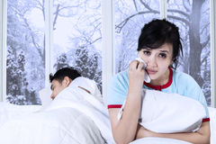 Asian lady crying on bed Stock Photos