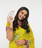 Asian lady with currency notes. Asian lady with indian currency notes royalty free stock image