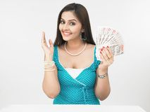 Asian lady with currency notes Stock Photography