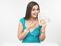 Asian lady with currency notes Royalty Free Stock Images