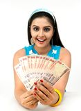 Asian lady with currency notes. Asian young lady with currency notes Stock Photography