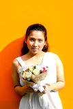 Asian lady in dress suite hold bouquet Stock Photo