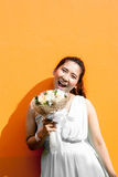 Asian lady in dress suite hold bouquet Royalty Free Stock Photo