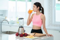 Asian lady drink a mixed fruit for healthy stock images