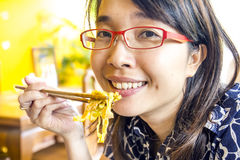 Asian lady is eating eating thai lanna noodles. Royalty Free Stock Image