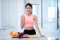 Asian lady eating a mixed fruit royalty free stock photo