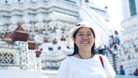 Asian lady enjoying for traveling at Wat Arun. Bangkok. Thailand. Slow Motion