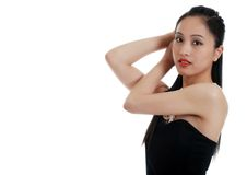 Asian lady fixing her hair Royalty Free Stock Images