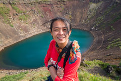 Asian lady in front of a crater lake in Iceland Royalty Free Stock Photo