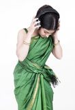 Asian lady with her headphones royalty free stock images