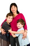 An asian lady with her two beautiful sons. Isolated on white Stock Images