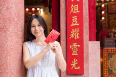 Asian lady holding red envelope or Ang-pow . Stock Photos