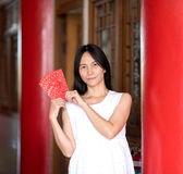 Asian lady holding red envelope or Ang-pow . Stock Photography