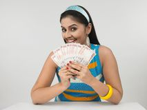 Asian lady with indian currency Stock Photo
