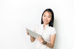 Asian lady with notepad. And smile isolated on white background Royalty Free Stock Photos