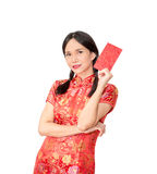 Asian lady in red  cheongsam suit  holding red envelope or Ang-p Stock Images