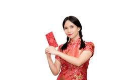 Asian lady in red  cheongsam suit  holding red envelope or Ang-p Royalty Free Stock Photography