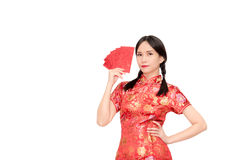Asian lady in red  cheongsam suit  holding red envelope or Ang-p Stock Image