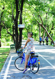 Asian lady riding bicycle royalty free stock image