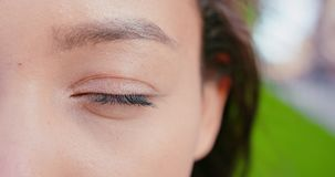 Asian Lady`s Eye Blinking Outdoors.  stock video footage