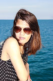 Asian lady on the sea. Asian lady with sunglasses on the sea royalty free stock image