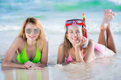Asian lady in bikini swim wear on the beach. With sunglasses, Mask diving,snokle and blue sea in Phuket, Thailand stock photo