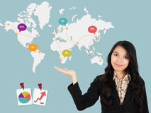 Asian lady shows the development of the world chart Stock Photo