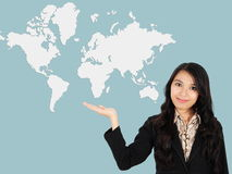 Asian lady shows the development of the world Royalty Free Stock Image