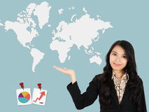 Asian lady shows the development of the world Stock Photography