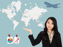 Asian lady shows the development of the world Royalty Free Stock Photo