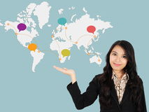 Asian lady shows the development of the world Royalty Free Stock Photography