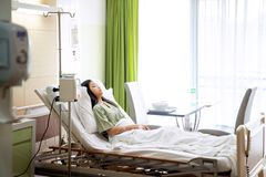 Asian lady sleep and patient in hospital with iv solution stock photos