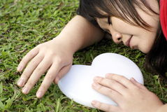Asian lady sleep with white heart Stock Image