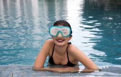 Asian lady smile with snorkle. On swimming pool royalty free stock photo