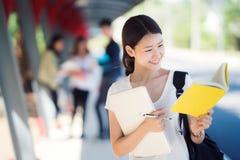 Asian lady student in university walking in walk way royalty free stock photos
