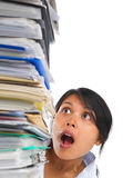 Asian lady surprised by high pile of paperwork Stock Photography