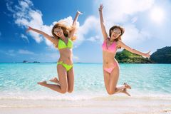 Asian lady in swimmer. Fun and jump on the beach in resort in Thailand, This immage can use for Travel, Holiday, Summer, Beach and Relax concept stock image