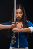 Asian lady with sword in studio Royalty Free Stock Photos