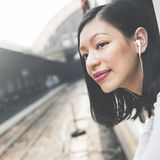 Asian Lady Traveling Commute Train Concept Royalty Free Stock Photography