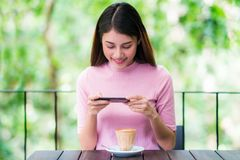 Asian lady use smartphone Royalty Free Stock Photos