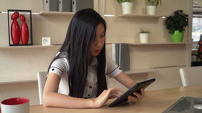 Asian lady use touch screen tablet in office. stock video