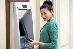 Asian lady using an automated teller machine Royalty Free Stock Images