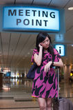 Asian lady waiting at the meeting point Stock Image