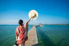 Asian lady walk in wooded bridge. To harbor in Koh Mak, Mak and Kood island is travel place in Thailand, This image can use for Holiday, summer, beach, sea and royalty free stock images