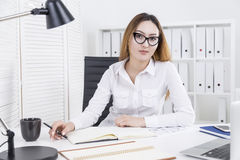 Asian lady working on project Royalty Free Stock Photos
